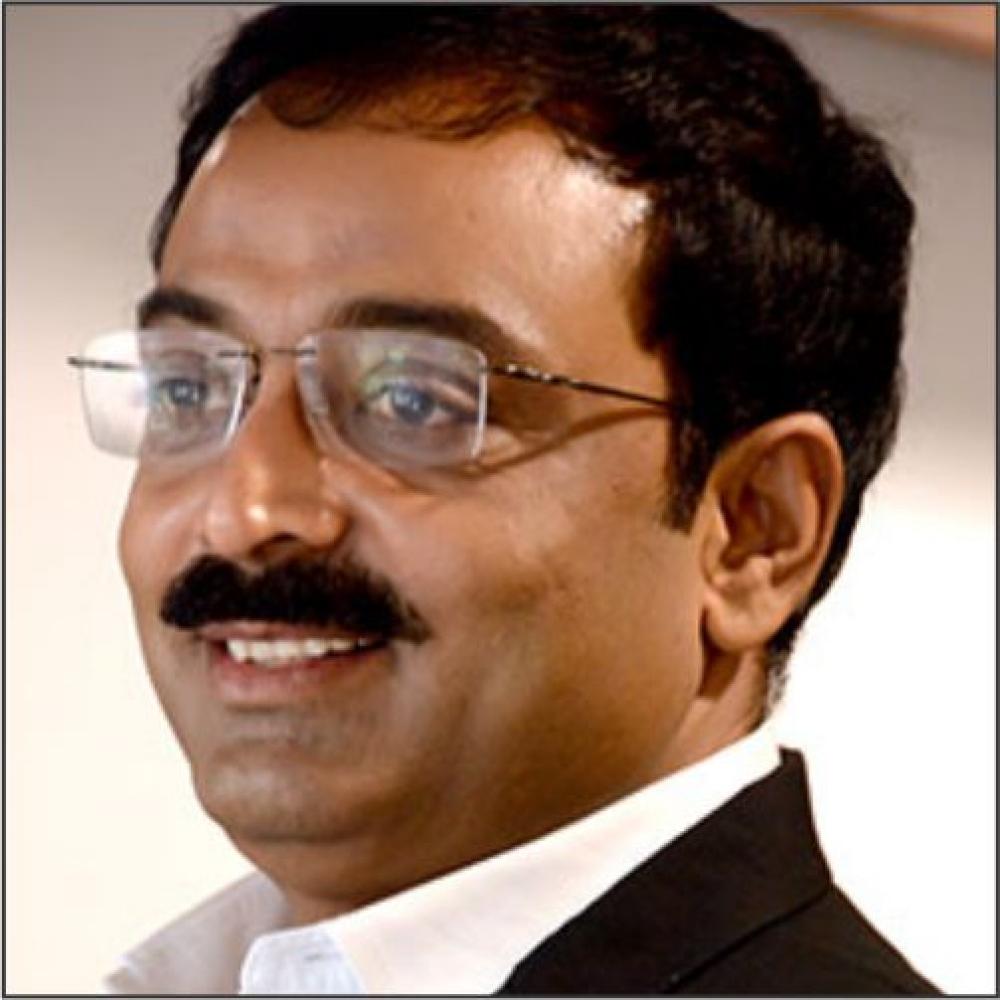 Mr. Nilesh Dhulesia